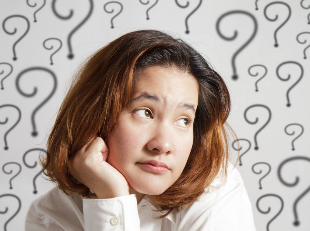 Woman with self-doubt has a lot of unanswered questions and an anxious expression on her face.